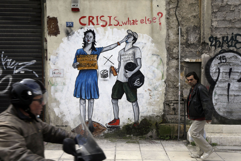 A pedestrian passes anti-austerity graffiti in Athens, Monday, Feb. 16, 2015. Greece's radical left government and its European creditors are heading into new talks Monday on the debt-heavy country's stuttering bailout program, but expectations are low despite a fast-approaching deadline for some kind of deal. (AP Photo/Thanassis Stavrakis)