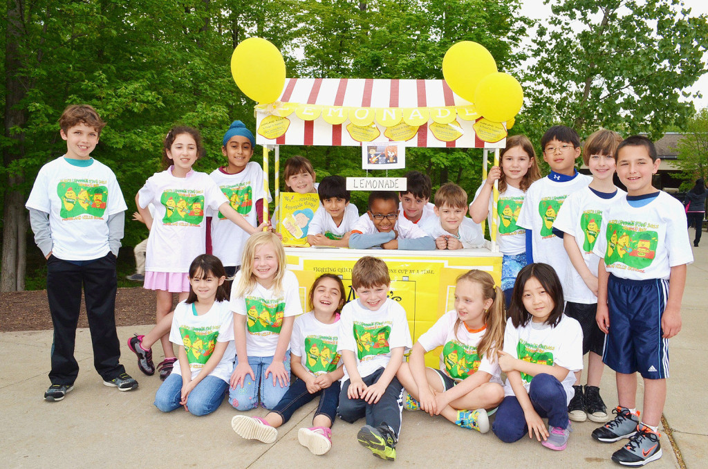 Second graders from Moreland Hills Elementary raise $2,000 for pediatric cancer selling lemonade at Alex's Lemonade Stand.